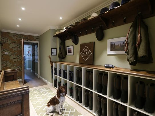 The Nare Boot Room with one of the hotel's hounds sat awaiting his next instruction