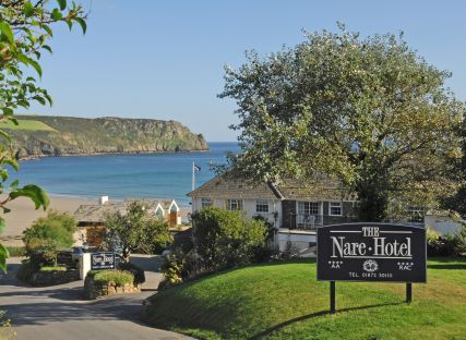 The entrance to The Nare, a luxury hotel in Cornwall, with the sea beyond.