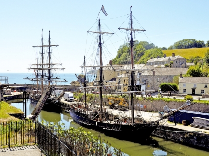 Tall ships anchored at Charlestown Harbour in Cornwall.
