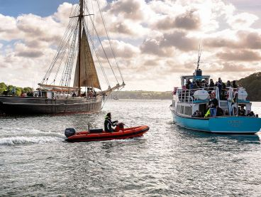 A ship, a ferry and a RIB on the River Fal.