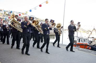A marching band in a Cornwall fishing village.