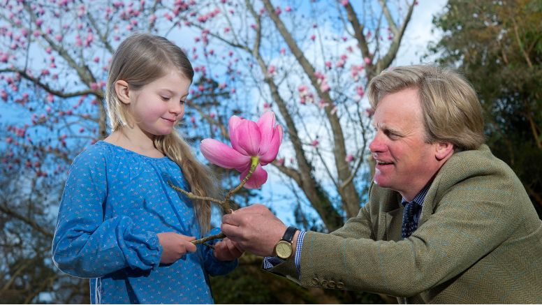 Toby Ashworth gives his daughter a pink magnolia flower.