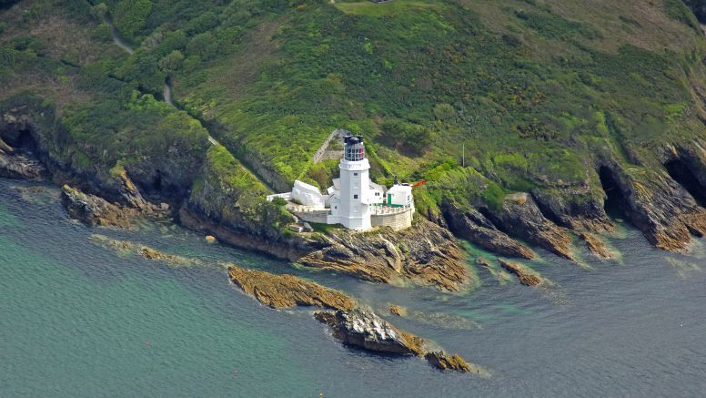 An aerial photo of St Anthony head and lighthouse, Falmouth.