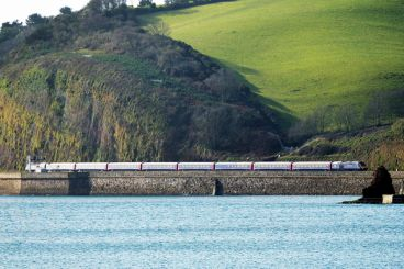 A train right by the sea in Cornwall.