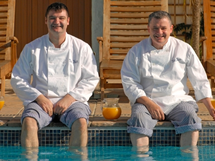 The chefs at The Nare dipping their feet in the hotel pool.