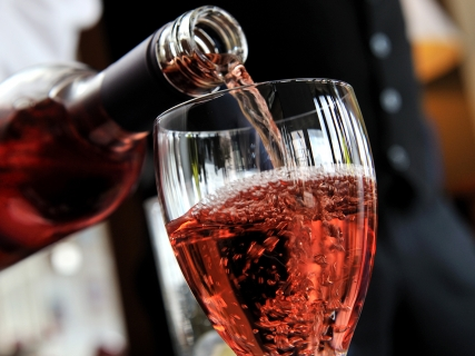Pouring a glass of rosé wine.