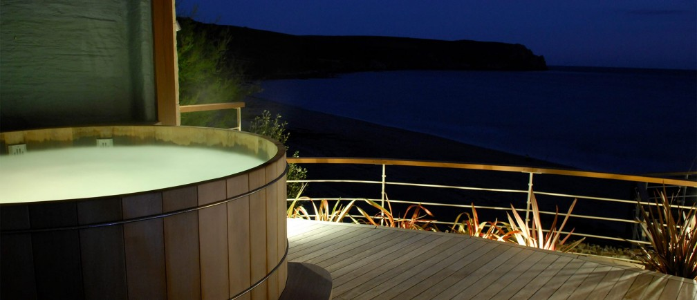The Nare hotel's hot tub at night.