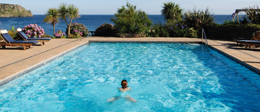 A guest enjoys the outside swimming pool at The Nare.