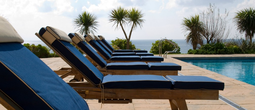 Sun loungers by the pool at Cornwall hotel The Nare.
