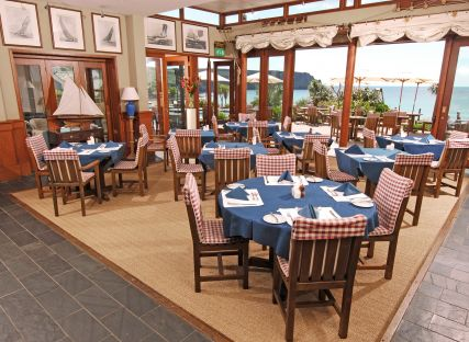 Tables set for service at The Quarterdeck restaurant in Cornwall.