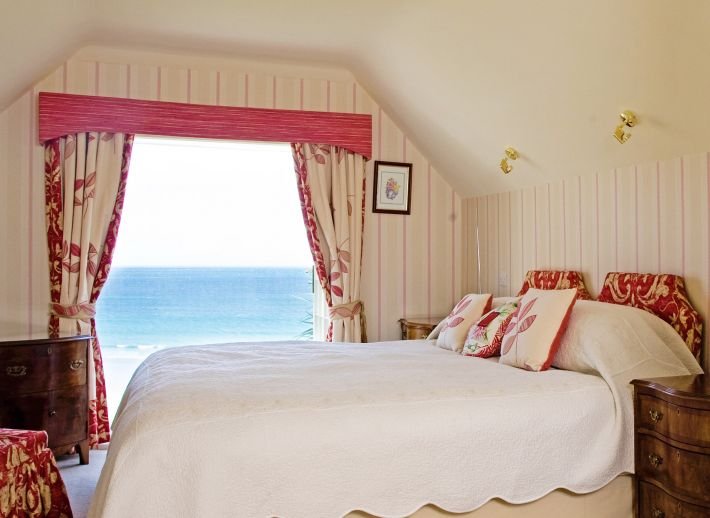 The sea view from the bedroom of Lemoria, a luxury cottage by the sea in Cornwall.