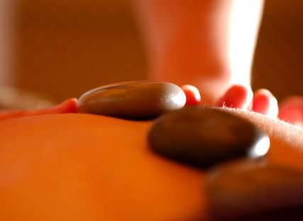 A hot-stone massage treatment.