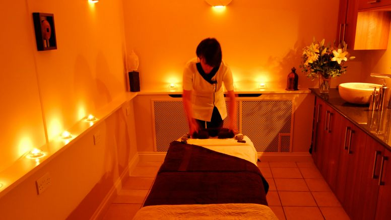 A therapist readies a massage table at Carne Bay Spa in Cornwall.