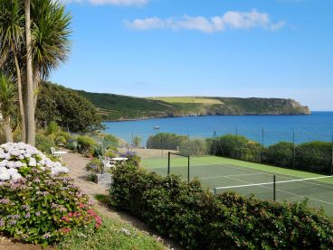The Nare hotel's all-weather tennis court with stunning sea views.