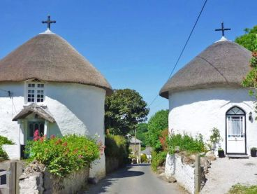 Thatched round houses in Veryan, Cornwall.